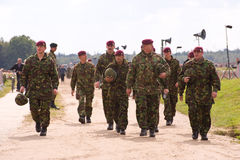 Paratroopers marching of after their drop Stock Photos