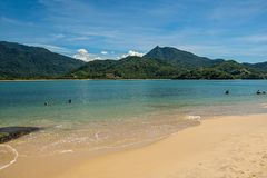 View of beach, sea and forest on sunny day in Ilha do Pelado, a tropical beach near Paraty. stock photos