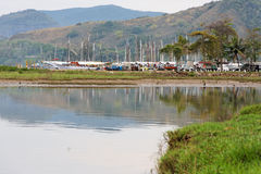 Paraty Marina Rio de Janeiro. The marina with its sailing boats reflecting on the mirror like tranquil waters of Paraty bay, Rio de Janeiro, Brazil stock images