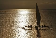 Paraw, Philippine Sailing Boat. Traditional sailboat in Philippines called Paraw sailing to the horizon on a dramatic sunset in the afternoon Stock Photography