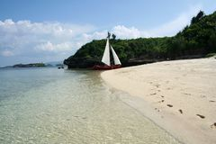 Paraw sailboat Beautiful boracay beach philippines. Local paraw sailboat on the white sand beaches of boracay island in the philippines Stock Images