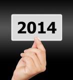 Parawanowy guzik z 2014 liczbami na ręce. Obrazy Stock