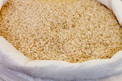 Parboiled rice in sack royalty free stock photos