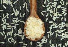 Parboiled rice in wooden spoon Royalty Free Stock Photography
