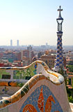 Parc Guell. A serpentine bench covered in trencadis, at Parc Guell, with view over Barcelona, Spain Stock Photo