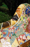 Parc Guell, Barcelona. The surreal Parc Guell by Antoni Gaudi, one of Barcelona's most popular tourist attractions - Colorful park bench decorated with glazed royalty free stock photos