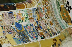 Parc Guell in Barcelona. Spain - long bunch with mosaic being designed by Gaudi Royalty Free Stock Images