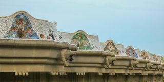 Parc Guell. Gaudí`s mosaic work on the main terrace. Shoot in the evening in June 2018 stock image