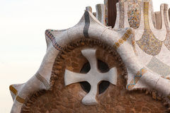 Parc Guell Museum Close-up. BARCELONA - AUGUST 31: Close-up of mosaic cross on the museum at the entrance of Parc Guell and aerial view of the city, Barcelona royalty free stock images