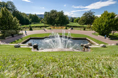 Monumental fountain with waterfalls in a French city park Royalty Free Stock Photography