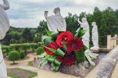 Parc Mondo Verde, the forgotten wedding bouquet in the park with on the end the back of a four Roman statutes. Stock Image