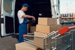 Free Parcel Boxes In Cargo Cart, Delivery Service Stock Photography - 164125312
