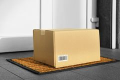 Parcel in cardboard box left. On door step royalty free stock images