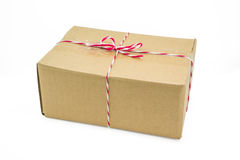 Parcel cardboard box and tied with string Stock Image