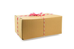 Parcel cardboard box and tied with string Royalty Free Stock Images