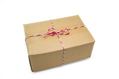 Parcel cardboard box and tied with string Stock Photography