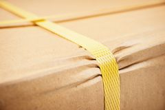 Parcel. Closeup detail of freight parcel with plastic strap stock photos