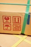 Parcel. Closeup detail of freight parcel with plastic strap stock image