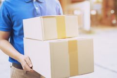 Parcel delivery man of a package through a service send to home. royalty free stock photos
