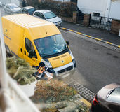 Parcel delivery by postal worker Stock Photography