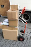 Parcel delivery. Trolley with pile of parcels ready for delivery Royalty Free Stock Photos