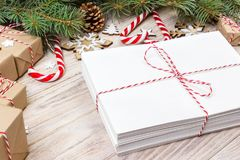 Parcel in Envelope with Fir-tree Branches and christmas decoration on a Wooden Background Stock Photo