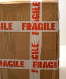 Parcel with fragile sticker royalty free stock photos