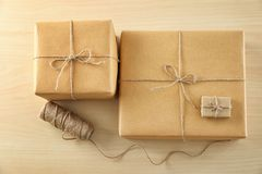 Parcel gift boxes. On wooden table royalty free stock image