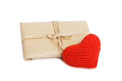 Parcel with kraft paper and red heart isolated on white Royalty Free Stock Photo