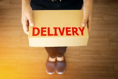 Parcel package delivery from delivery man , anonymous face.  Stock Photos