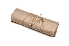 Parcel package wrapped with brown kraft paper tied rope Royalty Free Stock Image