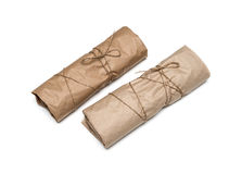 Parcel package wrapped with brown kraft paper tied rope Stock Image