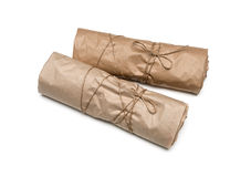 Parcel package wrapped with brown kraft paper tied rope Stock Photos
