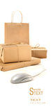 Parcel packages with computer mouse on white Royalty Free Stock Photo