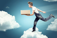 Parcel Service. Extraditable above the clouds in the sky Royalty Free Stock Photo