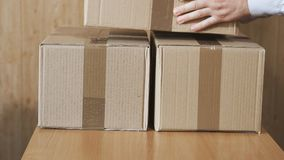 Parcel service. Preparation of postal parcels for delivery to customers at home stock video footage