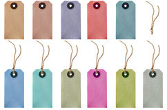 Parcel Tags and Strings Isolated. A selection of parcel tags in various different colours with and without strings.  Includes one detached string isolated Royalty Free Stock Photography