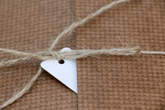 Parcel tied with white string with address label attached Royalty Free Stock Images