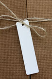 Parcel tied with white string with address label attached Stock Photo