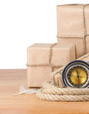 Parcel wrapped box and rope on white Stock Photography