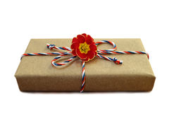 Parcel wrapped in brown eco paper tied with string isolated on white Stock Image