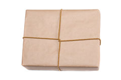 Parcel wrapped with brown kraft paper isolated on white backgrou Royalty Free Stock Photography