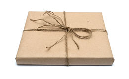 Parcel wrapped with brown kraft paper Royalty Free Stock Photography