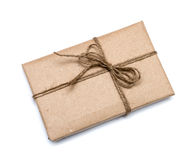 Parcel wrapped with brown kraft paper Stock Photos