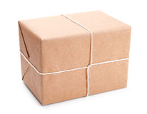 Parcel wrapped with brown packing paper Royalty Free Stock Photo