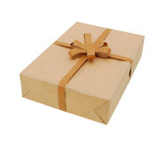 Parcel wrapped in brown packing paper. Small parcel wrapped in brown packing paper, tied with twine royalty free stock image