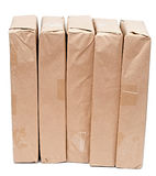 Parcel wrapped with brown paper Stock Image