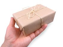Parcel wrapped in brown paper in man's hand Stock Photos