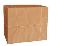 Parcel wrapped in brown paper and string, isolated Royalty Free Stock Photography
