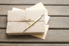 Parcel wrapped with brown paper on table Royalty Free Stock Image
